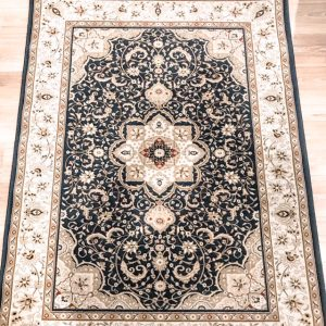large black persian rug for hire